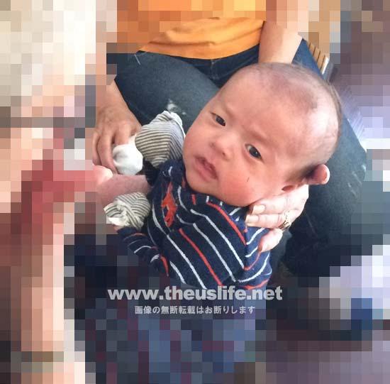 生後一ヶ月の日米ハーフの一重まぶたの赤ちゃんの顔